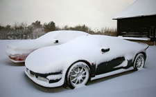 Car burried in snow? Winter tyres can help you stay mobile