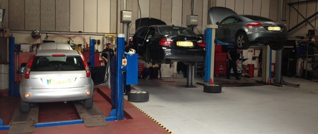 "Advanced Motorcare Radcliffe. <br><span style=""font-size:12px;"">All servicing and MOTs carried out in our multi-bay workshop by trained technicians</span>"